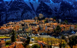 Preview wallpaper Greolieres, France, town, houses, Alps, tilt-shift photography