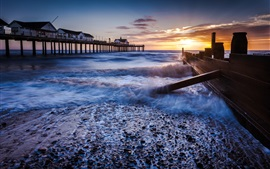 Preview wallpaper Pier, houses, fence, sea, waves, beach, morning, sky, sunrise, clouds