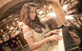Preview wallpaper Pretty asian girl play piano