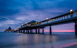 Preview wallpaper Sea, beach, pier, bridge, night, lights, blue purple sky, clouds