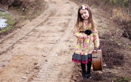 Beautiful cute girl take a suitcase
