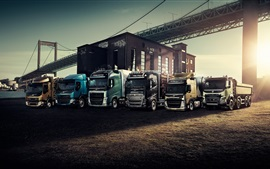 Preview wallpaper Volvo, trucks, bridge, sunset