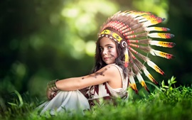 Cute little Indian girl, feathers hat