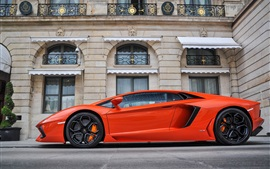 Preview wallpaper Lamborghini Aventador LP700-4 orange supercar side view, buildings