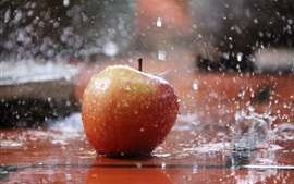 Preview wallpaper Red apple in the rain, water splash