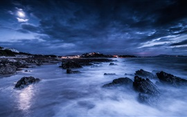 Preview wallpaper Sea, night, moon, clouds, rocks, shore, lights, blue
