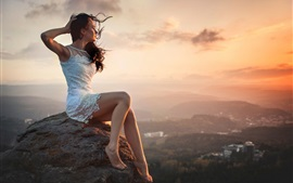 Preview wallpaper Sunset, girl, city, wind, height