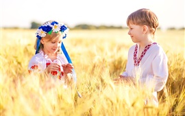 Preview wallpaper Ukraine, children, boy, girl, wheat field