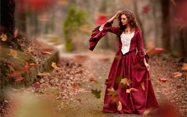 Preview wallpaper Autumn, leaves, red dress girl, wind