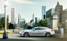 Porsche Panamera E-Hybrid white car in the city