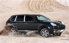 Preview wallpaper Porsche Cayenne Turbo black SUV car in desert