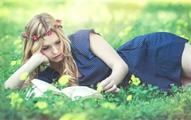 Preview wallpaper Beautiful girl read book, wreath, grass, flowers