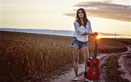 Preview wallpaper Long hair girl, guitar, sunset, fields