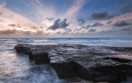 Preview wallpaper Ocean, surf, rocks, sky, clouds, dusk