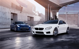 White BMW M6 and blue Nissan GT-R cars