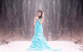 Preview wallpaper Blue dress girl, children, snow, bokeh