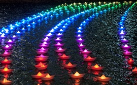 Colorful paper boats, rainbow color, night