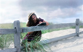 Preview wallpaper Girl read book, fence, outdoor