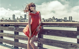 Preview wallpaper Smile girl, red dress, wind