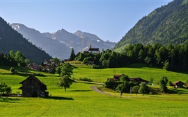 Preview wallpaper Switzerland, mountains, Alps, valley, grass, road, house, trees