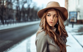 Preview wallpaper Brown hair girl, wind, hat, city