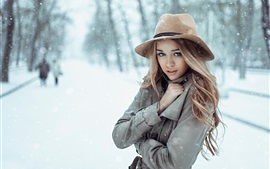 Preview wallpaper Girl in the snow winter, cold, hat