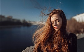 Preview wallpaper Long hair girl, portrait, sunlight, wind
