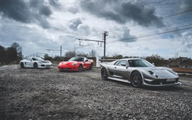 Preview wallpaper Three luxury supercars, dusk, road