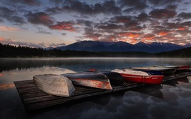Preview wallpaper Lake, boats, sunset, mountains, clouds