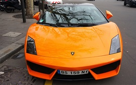 Lamborghini Gallardo orange supercar front view, reflection, city