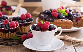 Preview wallpaper Raspberries, blueberries, cup, cakes