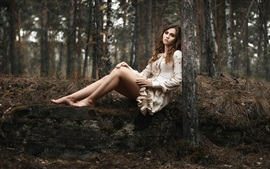 Preview wallpaper Girl in the woods, sadness, loneliness, legs