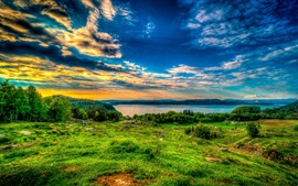 Preview wallpaper Sky, clouds, sunset, lake, trees, grass, rocks, sheep
