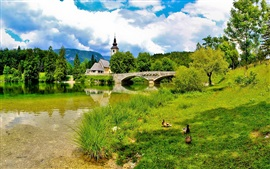 Preview wallpaper Slovenia, bridge, river, church, grass, summer, clouds