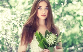 Beautiful young girl, portrait, bouquet lilies