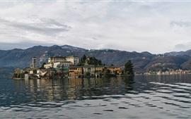 Italy, San Giulio island, mountains, houses, trees