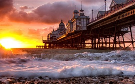 Sunrise, beach, pier, ocean, waves, buildings