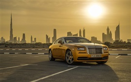 Gold color Rolls-Royce luxury car, Dubai, sunset