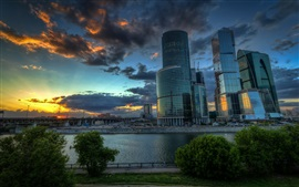 Preview wallpaper Moscow, Russian capital, skyscrapers, clouds, sunset, river, bridge