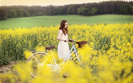 Preview wallpaper Smile girl, joy, bike, yellow flowers, field