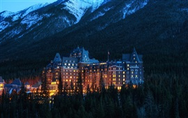 Preview wallpaper Alberta, Banff National Park, Canada, mountains, hotel, trees, evening, lights