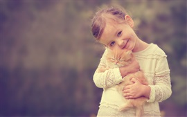 Preview wallpaper Cute girl holding a cat, smile