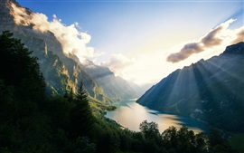 Preview wallpaper Klontalersee, mountains, trees, lake, clouds, sun rays, Switzerland