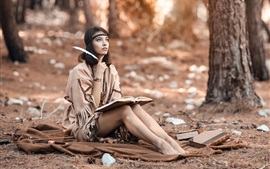 Preview wallpaper Long hair girl in the forest, reading book