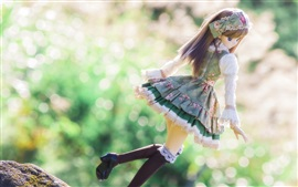 Preview wallpaper Beautiful girl, posture, doll, toy, bokeh