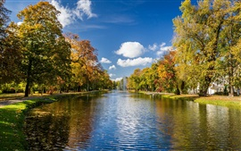 Park scenery, autumn trees, river, fountains, clouds