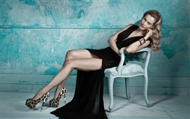 Preview wallpaper Blonde girl, black dress, legs, posture, chair
