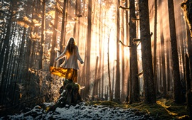 Girl in forest, trees, snow, sun