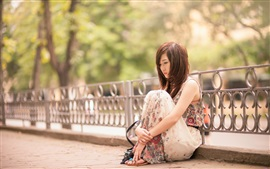 Preview wallpaper Sadness Asian girl, sit at street