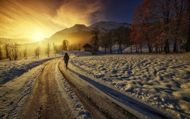 Preview wallpaper Sunrise, mountains, houses, road, girl, winter, thick snow
